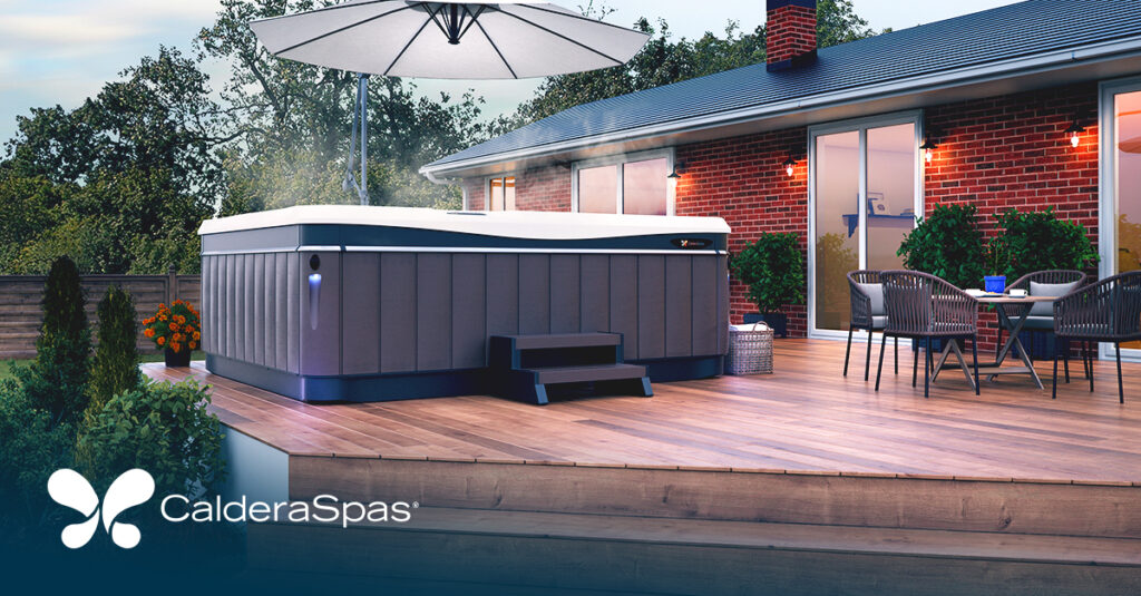 a caldera spas hot tub on the back deck of a brick ranch home